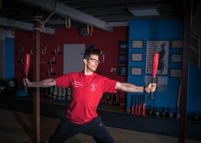 using batons to strengthen arm muscle